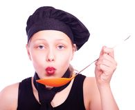 Teen girl with ladle Stock Images
