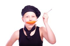 Teen girl with ladle Royalty Free Stock Photo