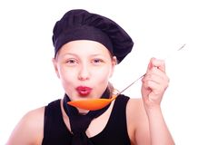 Teen girl with ladle Stock Photos
