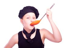 Teen girl with ladle Royalty Free Stock Images