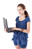 Teen girl with laptop. Teen girl, standing, holding laptop on her arm, looking at the camera. Studio shot Royalty Free Stock Photo