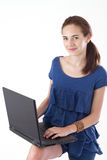 Teen girl with laptop. Teen girl, standing, holding laptop on her arm, looking at the camera. Studio shot Stock Photography