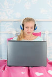 Teen girl with laptop Royalty Free Stock Photos