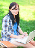 Teen girl with laptop Royalty Free Stock Images