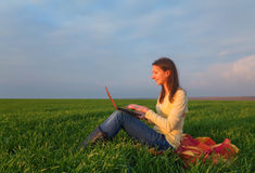 Teen girl with a laptop Royalty Free Stock Images