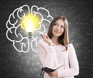 Teen girl, large brain and light bulb, chalkboard Stock Photography