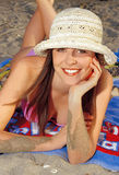 Teen girl laying on sand. Teen girl in swimsuit laying on sand beach Stock Photos