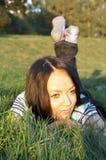 Teen girl lays Royalty Free Stock Photo
