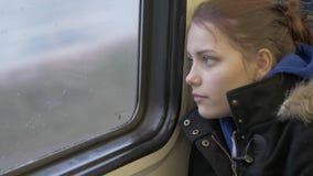 Teen Girl Leans Against Train Window stock footage
