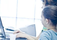 Teen girl learning computers Royalty Free Stock Photos