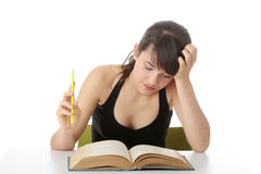Teen girl learning at the desk Royalty Free Stock Image