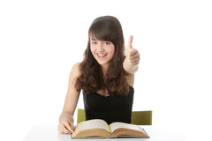 Teen girl learning at the desk Stock Images