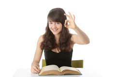 Teen girl learning at the desk Royalty Free Stock Photo