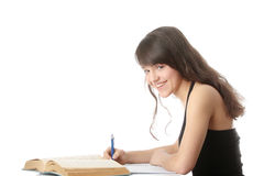 Teen girl learning at the desk Stock Image