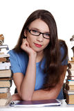 Teen girl learning at the desk Royalty Free Stock Images