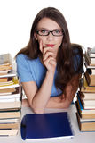 Teen girl learning at the desk Stock Photos