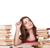 Teen girl learning at the desk, with lot of books Royalty Free Stock Images