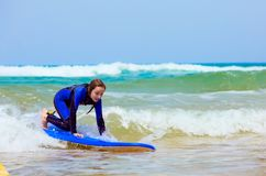 Teenage girl in blue has fun surfing stock photos