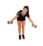 Teen girl lifting weight. A teenager girl in a black top and shorts standing for white background Royalty Free Stock Image
