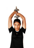 Teen girl lifting weight. Royalty Free Stock Photo