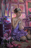 Teen girl in a lilac dress Stock Image