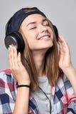 Teen girl listening enjoying music Stock Images