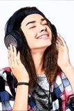 Teen girl listening enjoying music stock photos