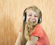 Teen girl listening music Stock Images