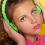 Teen girl listening music on headphones Stock Photo