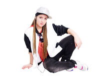 Teen girl listening music by headphones over white Royalty Free Stock Images