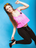 Teen girl listening music mp3 and dancing Royalty Free Stock Photography