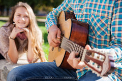 Teen girl listening to the guitar Royalty Free Stock Photography