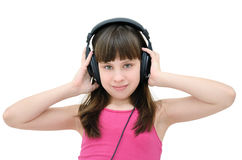 Teen girl listening to headphones, isolated on white background. Stock Photos