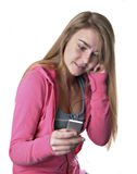 Teen girl listening to i-pod. A pretty teen girl in birhgt clothing listening to her i-pod Stock Photos