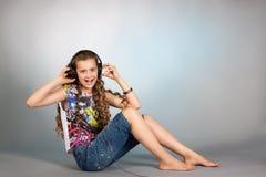 Teen girl listening to music Stock Photos