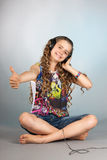 Teen girl listening to music Royalty Free Stock Photography
