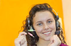 Teen girl listening to music with headphones Royalty Free Stock Photos
