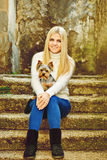 Teen girl with little dog Royalty Free Stock Image