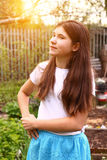 Teen girl with long brown hair close up photo Stock Photos