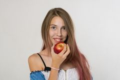 Teen girl with long hair and Apple smiles stock photo