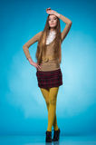 Teen girl with long straight hair. Beautiful teen girl with long straight hair, posing on blue background Stock Photography
