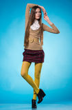 Teen girl with long straight hair. Beautiful teen girl with long straight hair, posing on blue background Royalty Free Stock Image
