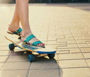 Teen girl on longboard on the street Royalty Free Stock Image