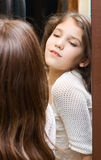 Teen girl look at mirror Stock Image