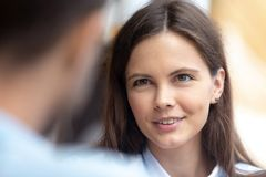 Free Teen Girl Looking At Boyfriend Talking To Friend At Meeting Stock Photo - 144183450