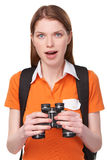 Teen girl looking through binoculars Royalty Free Stock Image