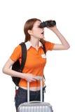 Teen girl looking through binoculars Stock Images