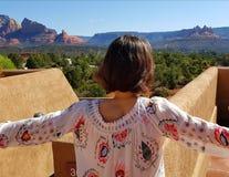 Teen girl looking over Sedona. A teenage girl on a balcony looking over Sedona red rocks in Arizona stock image
