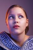 Teen girl looking up with interest, portrait Stock Image