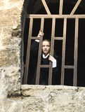 Teen Girl Looks Out Of The Jail Window Stock Photography